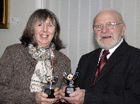 Val Kressman receiving the awards for Best Print and Best DPI in the General Category from Club President Bobby Haines