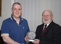 Iwan Williams receiving the Bobby Haines Image of The Year Trophy from Club President Bobby Haines